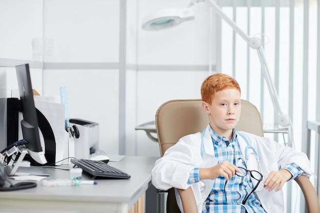 Cute boy playing doctor