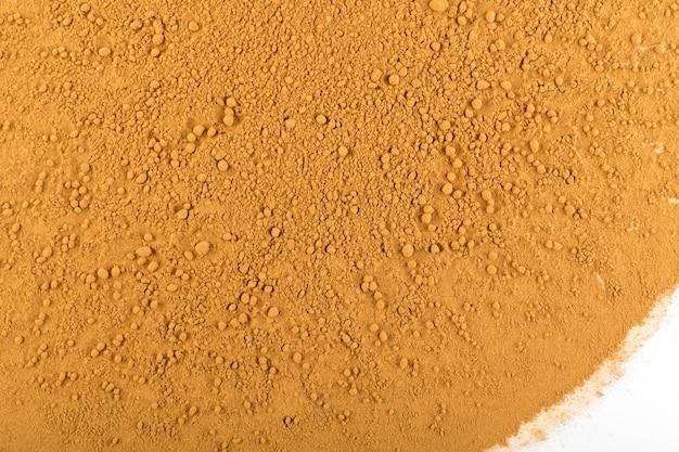 Cynamonowa tekstura proszku. widok z góry zbliżenie kory cinamon zmielonej kory