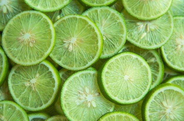 Cytrus owoc wapno pokrajać tło
