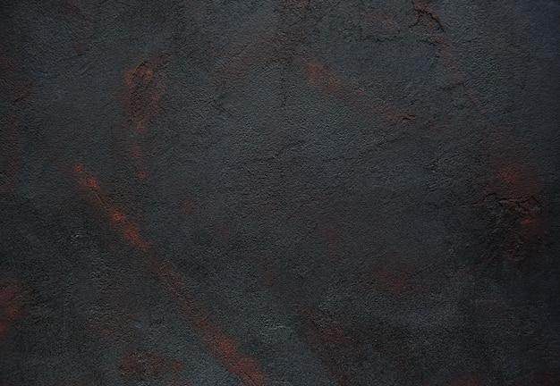 Czarna betonowa tekstura rdzewiał abstrakcjonistycznego tło