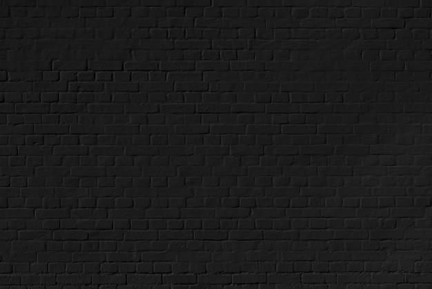 Czarna cegła ściana tekstur. budynek architektoniczny tła.