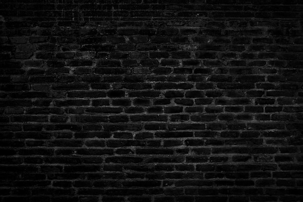 Czarna cegła ściana tekstur na tle.