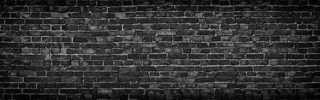 Czarna ceglana ściana z panoramicznym widokiem w wysokiej rozdzielczości
