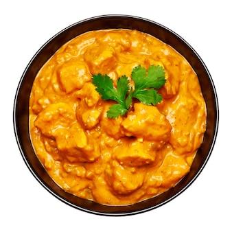 Czarna ceramiczna miska tradycyjnego curry z kurczaka na białym tle