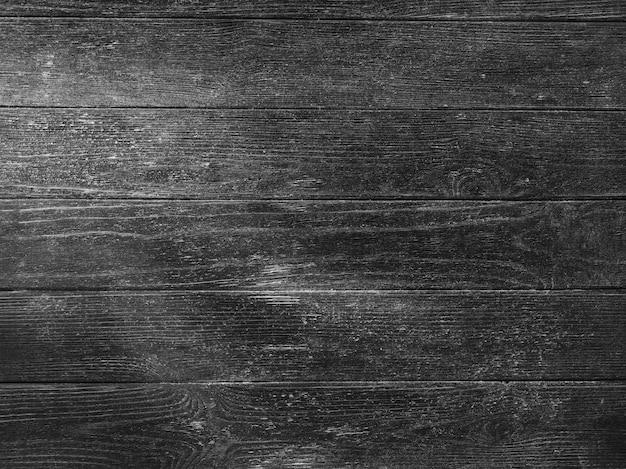 Czarna drewniana tekstura z wiązką światła