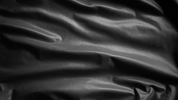 Czarna flaga macha z wiatrem. ciemny transparent z miękkiego jedwabiu. chorąży tekstury tkaniny