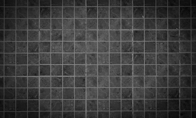 Czarna kafelkowa ściana wysokiej rozdzielczości prawdziwe zdjęcie lub cegła bez szwu wzór i tekstura tło wnętrza pokoju