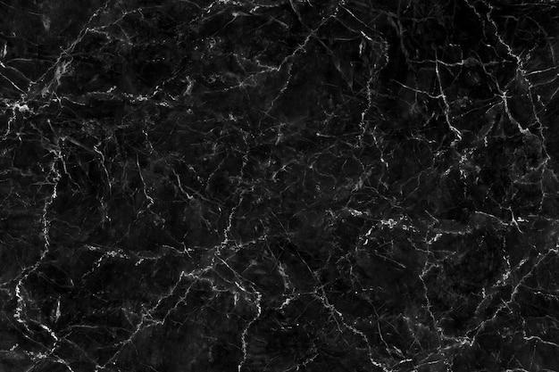 Czarna marmurowa tekstura z naturalnym wzorem dla tła lub prac projektowych.