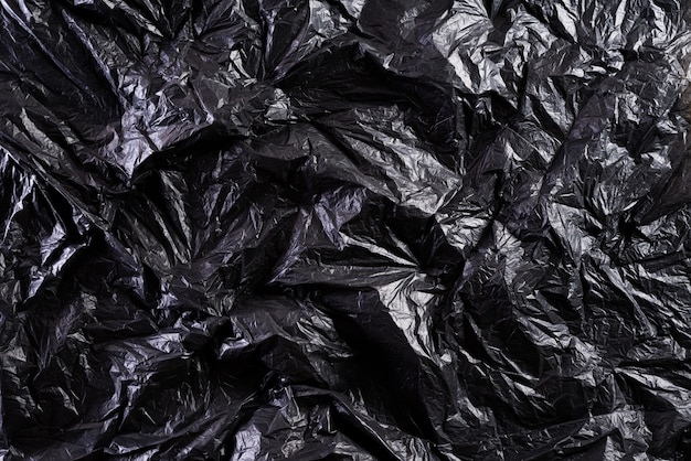 Czarna plastikowej torby tekstura, tło, przetwarza i środowiska pojęcie.
