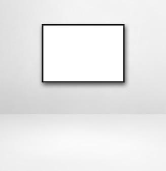 Czarna ramka na zdjęcia wisząca na białej ścianie. pusty szablon makiety