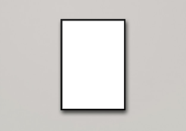 Czarna ramka na zdjęcia zawieszona na jasnoszarej ścianie.
