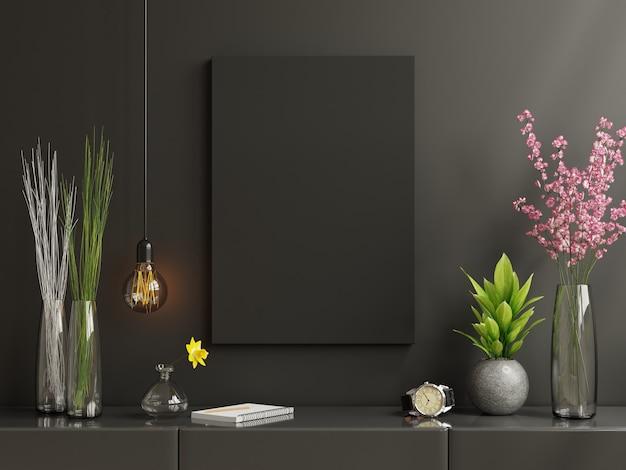 Czarna ramka plakatowa na szafce we wnętrzu salonu na pustej ciemnej czarnej ścianie, renderowanie 3d