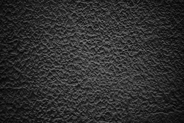 Czarna ściana streszczenie, ciemna tekstura cementu jako tło