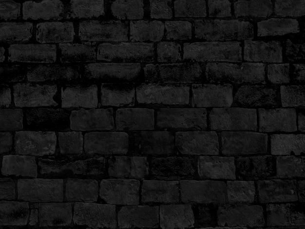 Czarna ściana z cegieł tekstura budynek.