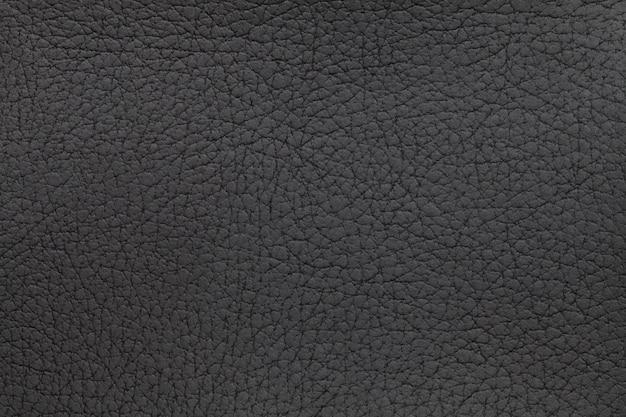 Czarna skóra tekstura tło. zbliżenie zdjęcie. gadów skóry.