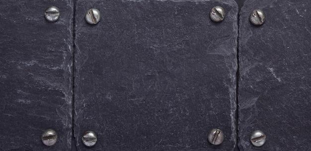 Czarna tekstura kamienia łupkowego jako tło suface, widok z góry