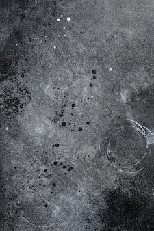Czarna tekstura, szorstkie tło. betonowa ciemna podłoga, stary tło grunge