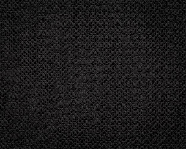 Czarna tkanina tekstura. ciemne tło wzór włókienniczych. szczegół materiału syntetycznego.
