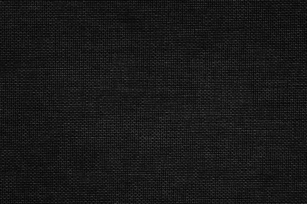 Czarna tkanina tekstylna teksturowana tło