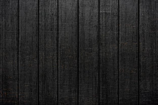 Czarne drewniane deski z teksturą tła