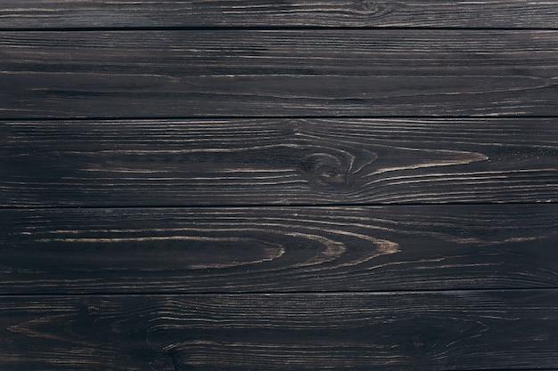 Czarne drewniane tła.