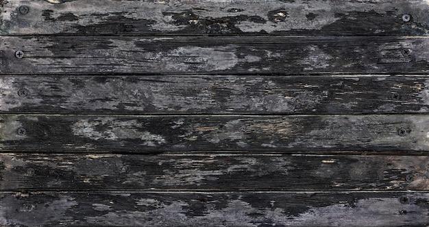 Czarne drewno tło zwęglone deski malowane czarne bejce