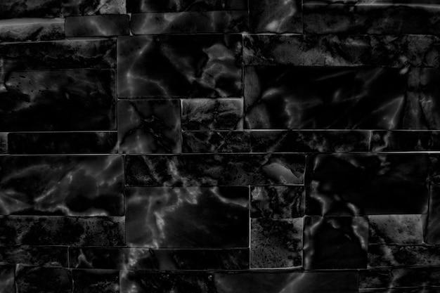 Czarne marmurkowe płytki teksturowane w tle
