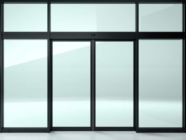 Czarne podwójne automatyczne szklane drzwi w sklepie lub w witrynach.