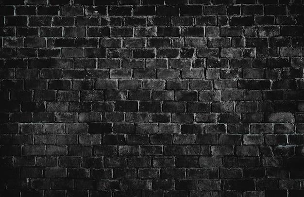 Czarne teksturowane tło ściany z cegły