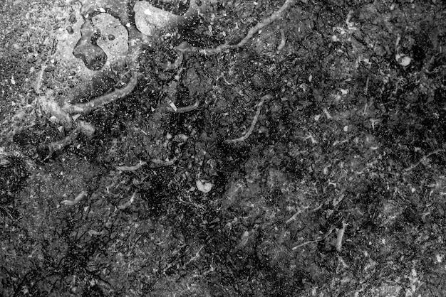 Czarne tło marmuru z teksturą rozlanej wody