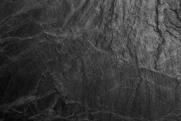 Czarne tło powierzchni kamienia. do projektowania i jako tło