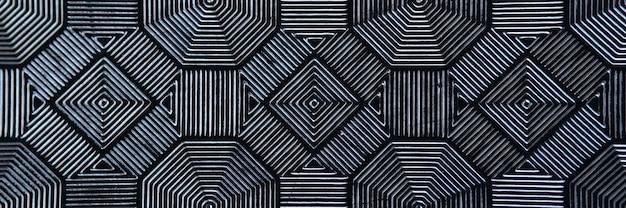 Czarne wzorzyste płytki w formie rombów koncepcja wzorów podłogowych i ściennych