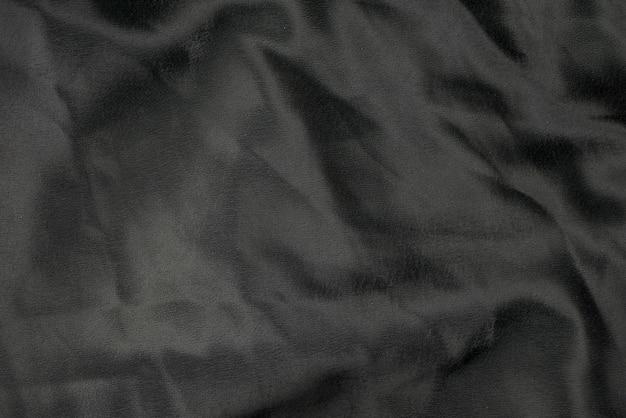Czarnej tkaniny tła sukienna tekstura