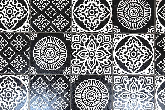 Czarno-białe kafelki w stylu vintage, mogą służyć jako tło
