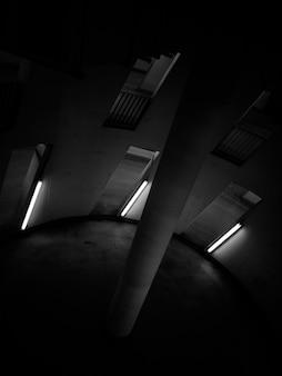 Czarno-białe zdjęcie okrągłego pokoju z filarem pośrodku