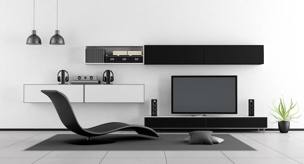 Czarno-biały pokój z telewizorem i szezlongiem