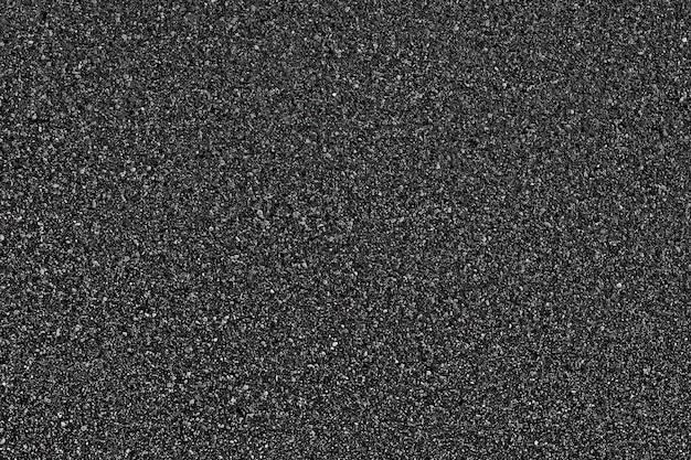Czarny asfaltowy tekstury tło. widok z góry.