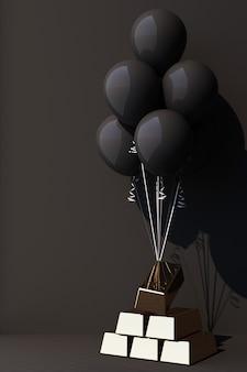 Czarny balon zawiązany złotą sztabką i podciągający go do góry