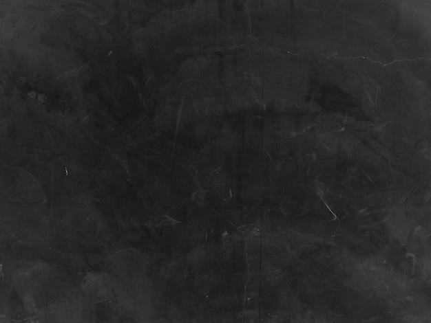 Czarny betonowej ściany pęknięcia tło. ściana cementowo-kamienna kolor czarny