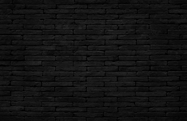 Czarny ceglany mur tekstura tło ze starym wzorem w stylu brudnym i vintage