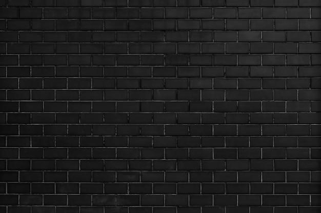 Czarny ceglany mur teksturowanej tło