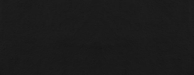Czarny cement ściana tekstura tło. szorstka tekstura.