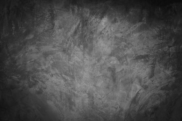 Czarny, ciemny i szary streszczenie cementu ściany i studio pokoju tło gradientowe