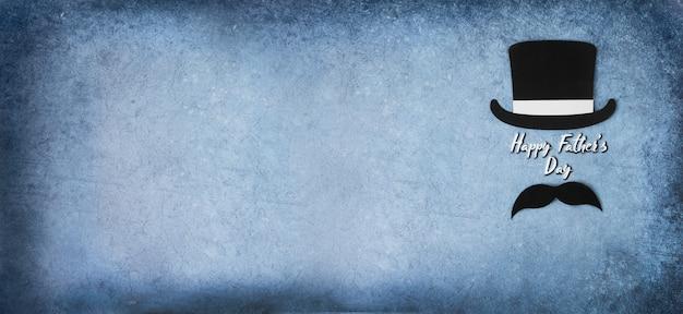 Czarny cylinder i wąsy na niebieskim tle kartka z życzeniami dzień ojca