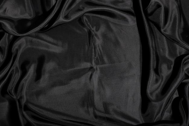 Czarny jedwabnej tkaniny tekstury tło