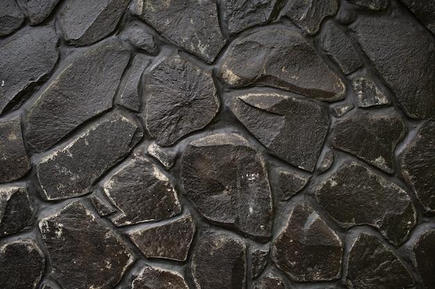 Czarny kamienny mur tekstury. bali. indonezja