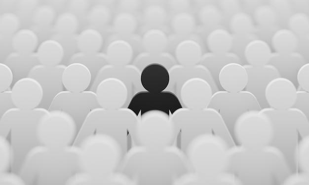 Czarny kolor figurki wśród tłumu białych ludzi tło