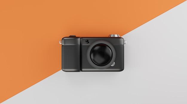 Czarny kompaktowy aparat na pomarańczowo-białym tle koncepcji podróży. renderowanie 3d