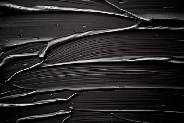 Czarny kremowy tekstura tło produkt kosmetyczny i tło do makijażu na wakacje luksusowej marki kosmetycznej ...