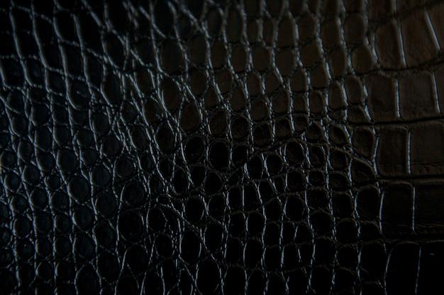 Czarny krokodyl tekstury skórzany tło